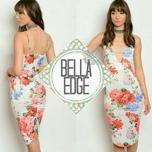 Bella Edge Dresses & Skirts - Ivory floral ruched back plunge midi dress