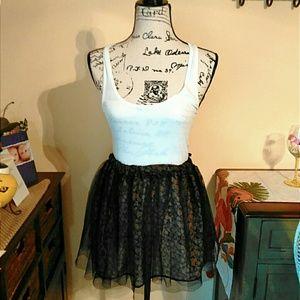 Dresses & Skirts - 🎉HP🎉 Poofy Black Skirt w/ Flower Patterns