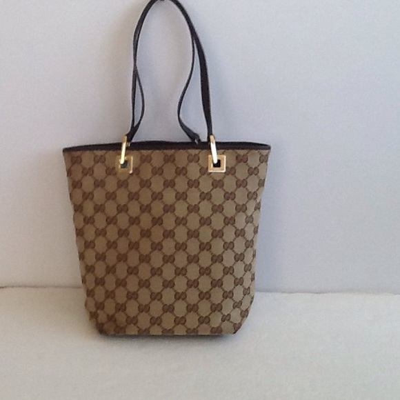 Gucci Handbags - Authentic Gucci Brown Monogram Canvas Small Tote. c48484960f915