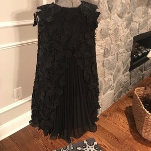 chicwish Dresses & Skirts - So unique! Black lace swing dress with split back!