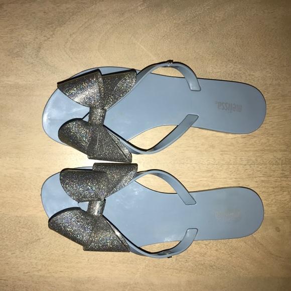 acc47d82d0b0c Melissa silver bow flip flops. M 58e2fc92291a3523430ea4fb