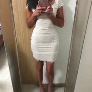 Gorgeous Bebe white lace dress with nude lining!