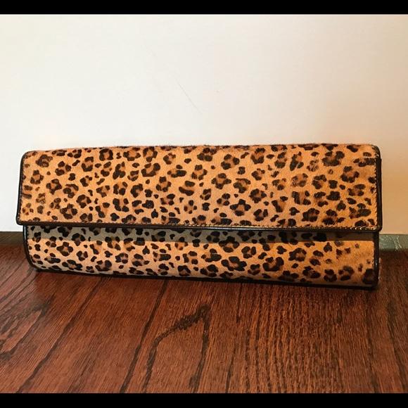 4afb88c58be Aldo Handbags - Aldo leopard print clutch