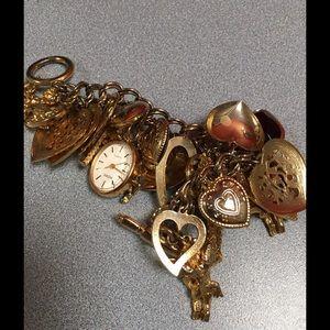 Jewelry - Charm bracelet with watch.  Such a fun Piece..