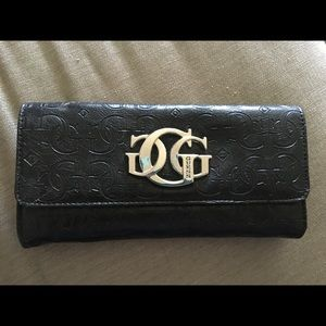 Guess Handbags - Guess Black Trifold Wallet Lots of space!!!