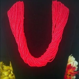 Coral color seed bead necklace and bracelet set.