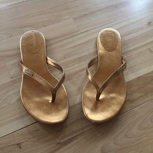 ec5a9234a4015c Gucci Shoes - Gucci Metallic Gold Leather Logo Script Flip Flops