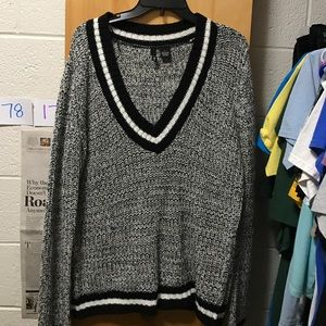 Oversized black and white sweater moving out