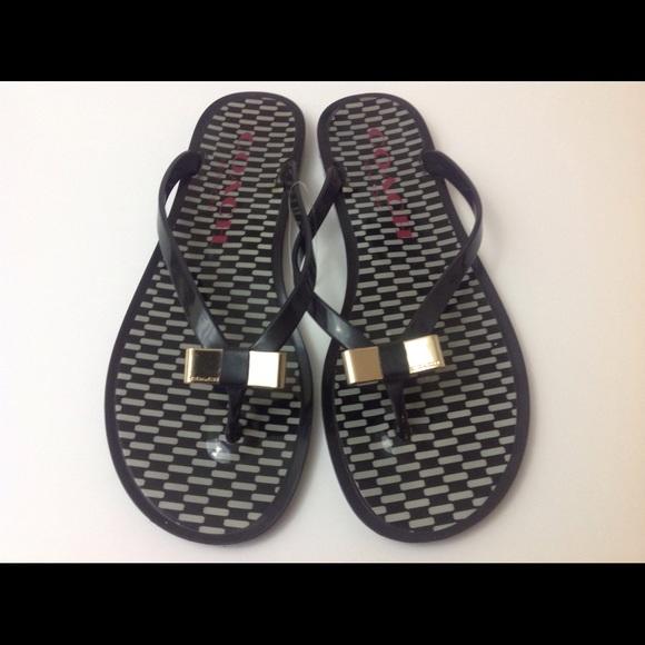2f1a04e9f80ad7 Coach Shoes - Coach Flip Flop Jelly Sandal BLACK White Gold Bow