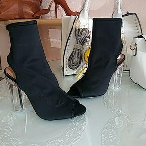 Black stretchy lycra open toe, clear heel bootie
