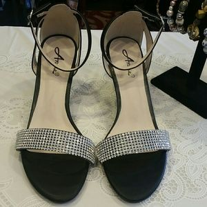Beautiful black and silver heels Size 10 M