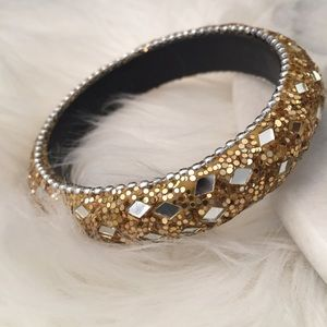 Gold bracelet with silver details and sparkle