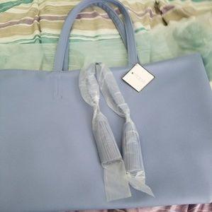 Macy's Handbags - MACY'S LIGHT BLUE TOTE WITH TASSELS.