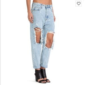 Unif extreme ripped light washed Jeans.