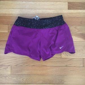 Purple Nike shorts