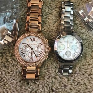 Two Michael kors watches. Comes with links and box