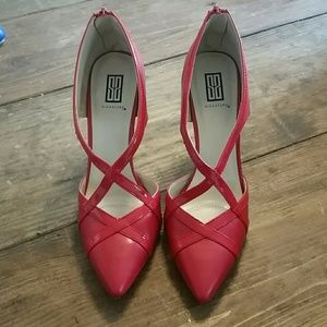 Red criss cross pumps