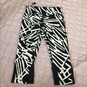 Black and white NIKE epic lux workout pants