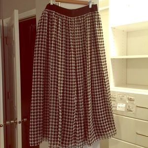 Long houndstooth skirt.