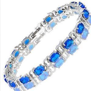 Blue Topaz CZ & 18K White GP Tennis Bracelet