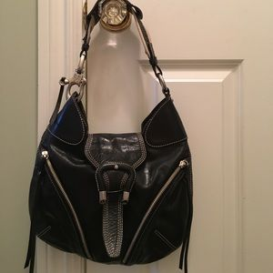 Black leather bag with canvas stitching