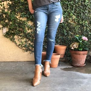 Light wash distressed U hem jean