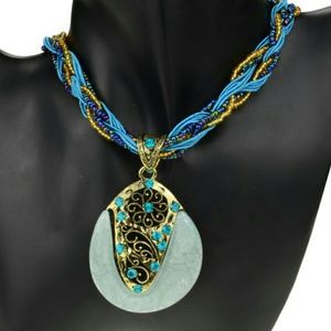 Jewelry - Blue teardrop pendant with braided necklace