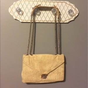 Faux Ostrich Adjustable cross-body purse.