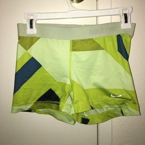 Nike Pro shorts, size M, yellow/green/blue