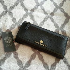 Vince Camuto Handbags - Vince Camuto leather wallet w/ gold embellishment