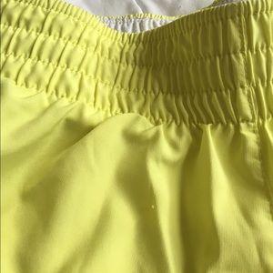Nike Shorts - yellow nike dri-fit shorts size S