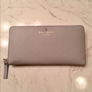 Brand new light gray Kate Spade Wallet.