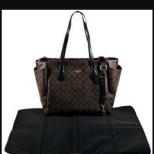 Coach diaper bag with changing pad