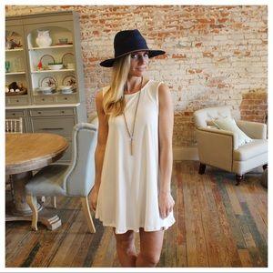 Dresses & Skirts - White sleeveless swing dress