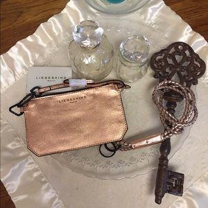 Liebeskind Handbags - Liebeskind Rose Gold Wristlet/&Keychain