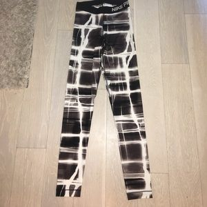 Black and white Nike Dri-Fit athletic leggings