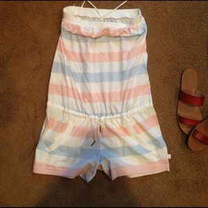 Adidas romper in millennial pink and baby blue.
