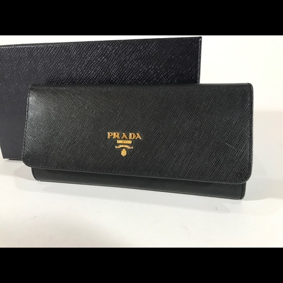 da6e99fdfbef Prada Women's Saffiano Leather Continental Wallet.  M_58f16335981829517a022c31