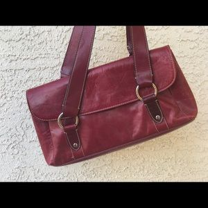 Ruby red bag with vinyl trim.