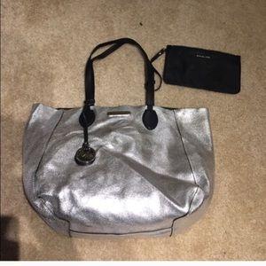 Michael Kors Handbags - Michael Kors Reversible Silver/Black large bag