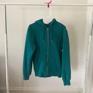 Teal hoodie with silver zipper.