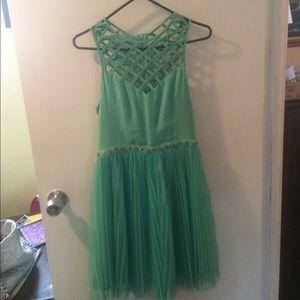 Light teal cocktail dress or prom dress .