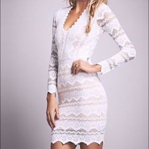 Nightcap Dresses & Skirts - Nightcap Sierra Lace Deep V Dress