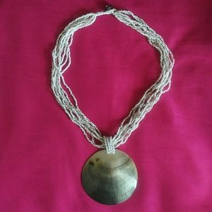 Beaded necklace with large shell pendant