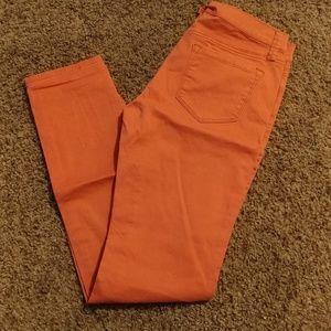 JCPenneys orange skinny pants