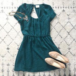 Dark green brocade dress