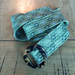 Green fabric belt with tortoise buckle