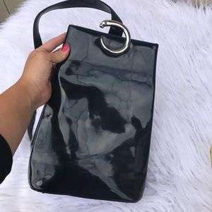 Cartier Handbags - CARTIER 1990s PATENT LEATHER PUMA MINI BACKPACK