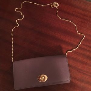 Handbags - Coach purse cross. Odd or wallet