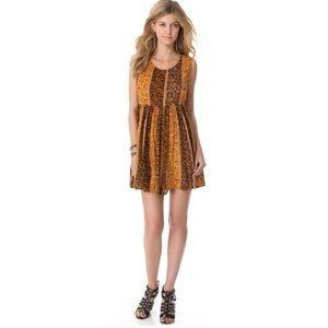 MINKPINK Dresses & Skirts - MinkPink Gold & Black Animal Print Babydoll Dress